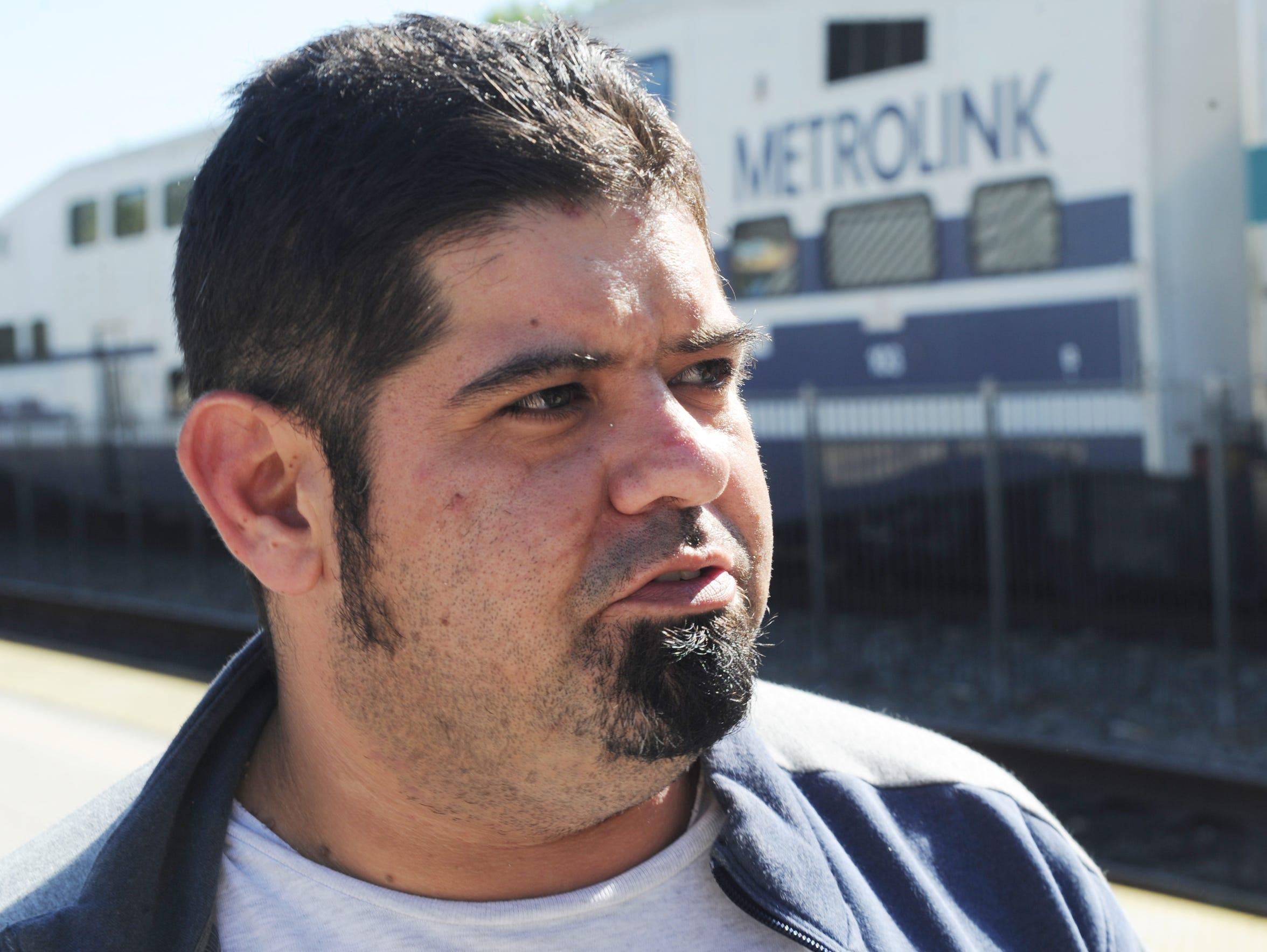 Carlos Romero, of Moorpark, waits to take a Metrolink