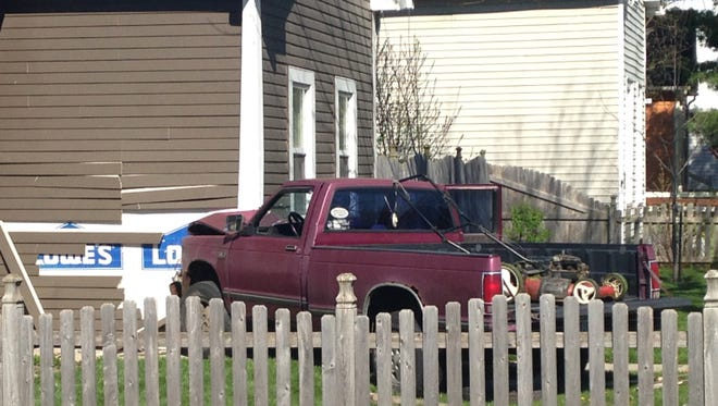 A woman and man inside this residence at the corner of Terrace Avenue and South New Jersey Street were seriously injured Friday afternoon, when a pickup truck struck the house.