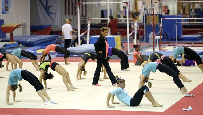 In this Sept. 12, 2015, file photo, Martha Karolyi, national team coordinator for USA Gymnastics, watches over gymnasts during a training session at the Karolyi Ranch in Huntsville, Texas.