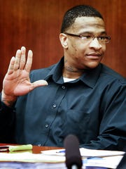 Quinton Tellis, 29, waves to family before his trial
