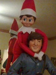 Our elf didn't seem to like this John Lennon statue.