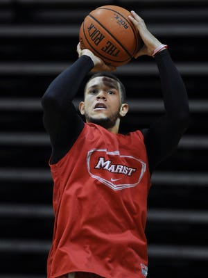 Marist College senior guard T.J. Curry shoots at practice at the McCann Arena on Friday in the Town of Poughkeepsie. Nov. 7, 2014