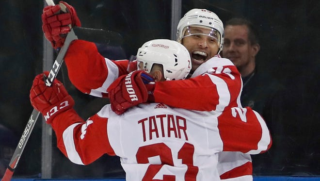 Red Wings defenseman Trevor Daley (83) celebrates with Red Wings left wing Tomas Tatar (21) after scoring the winning goal during overtime of the Wings' 3-2 win over the Rangers on Sunday, Feb. 25, 2018, in New York.