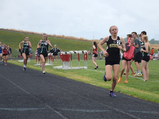Buffalo Gap's Annika Fisher heads for the finish line to win the girls 800-meter run at the Shenandoah District track and field championships, held on Wednesday, May 16, 2018, at East Rockingham High School in Elkton, Va. The Bison junior also won the 1,600.