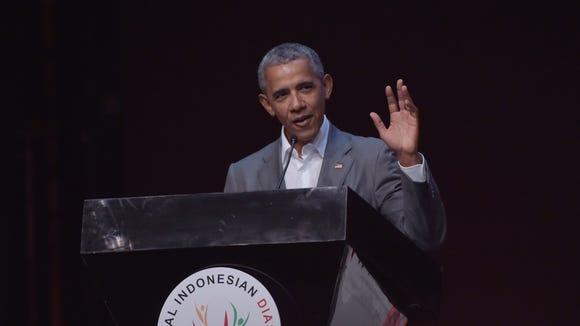 Former president Barack Obama delivers a speech during