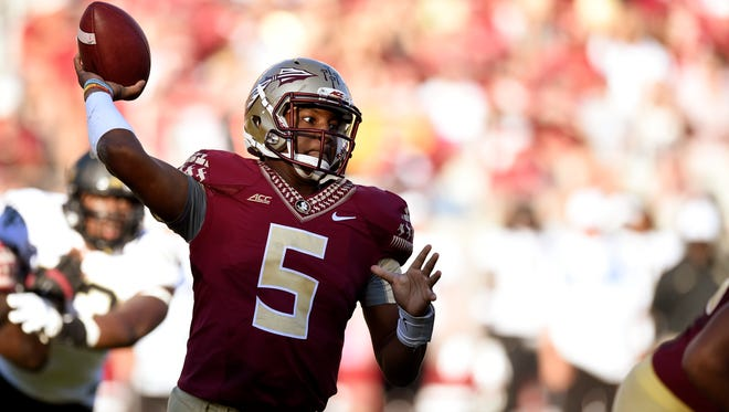 FSU quarterback Jameis Winston (5) drops back to pass against the Wake Forest Demon Deacons during the fourth quarter at Doak Campbell Stadium. Florida State Seminoles defeated the Wake Forest Demon Deacons 43-3.