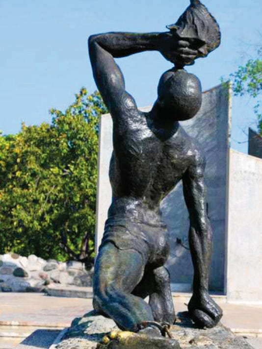 "Iconic image of ""Unknown Slave statue at the Champs de Mars, Haiti."""