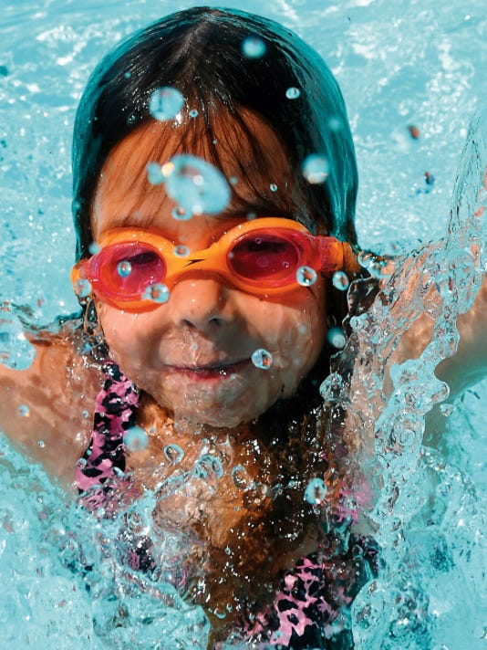 Robin Zielinski   Sun-NewsTaylor Rogers, 8, plays in the Desert Hills swimming pool on Thursday.