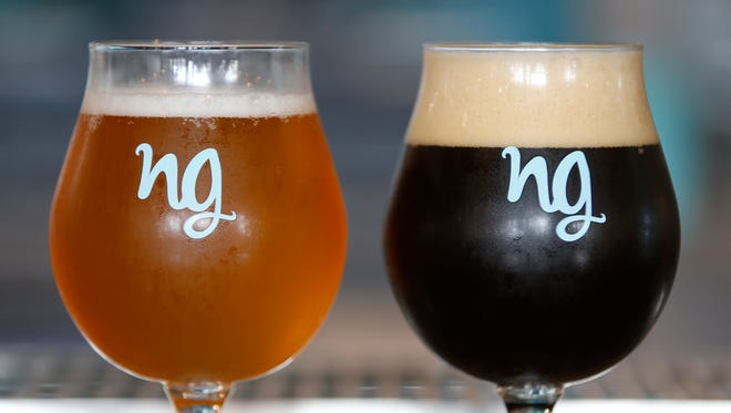 A Belgian single beer, called Django (left), and a Texas brown beer (right), known as the S.R.V., or Stevie Ray Vaughn, sit on the bar at Nine Giant brewery.