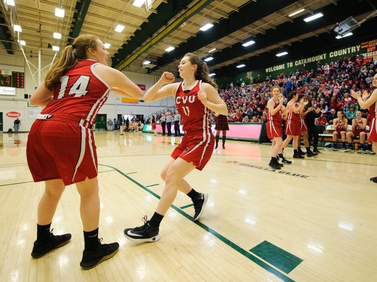 CVU's Meghan Gilwee (11) talks the court during player introductions in the Vermont high school girls division I basketball championship between the St. Johnsbury Hilltoppers and the Champlain Valley Union Redhawks at Patrick Gym on Sunday afternoon March 11, 2018 in Burlington.