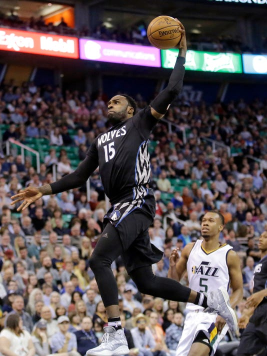 Minnesota Timberwolves forward Shabazz Muhammad (15) goes to the basket as Utah Jazz guard Rodney Hood (5) watches during the first half in an NBA basketball game Friday, April 7, 2017, in Salt Lake City. (AP Photo/Rick Bowmer)