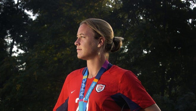 Abby Wambach won gold at the 2004 Olympics in Athens, Greece.