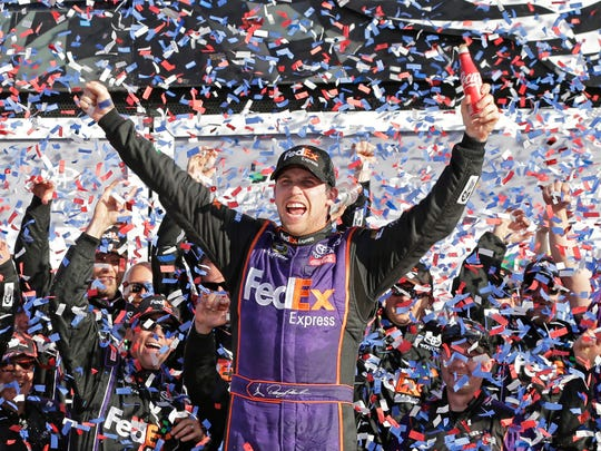 It' confetti and a Coke for Denny Hamlin in Victory Lane on Sunday.