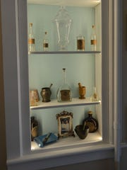 Old glass medicine bottles and other artifacts preserved