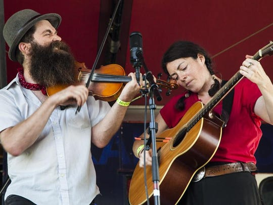 Aaron Jonah Lewis and Lindsay McCaw, members of The Corn Potato String Band, are among the musicians who founded the Detroit Square Dance Society.