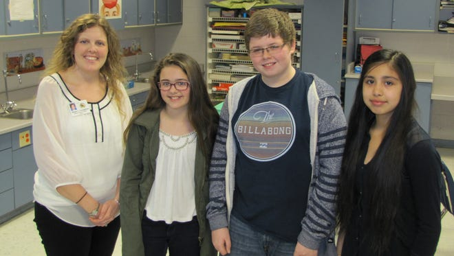Madison Munn, Brendan Hartley and Jennifer Hernandez were part of Megan Fenoglietto's first block class, which collected the most goods for The Spirit Kitchen as part of the Soup Kitchen Throwdown.