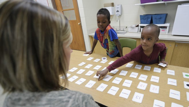 Ethan Jordan, right, and Alhamdu Basas work with Jacci Engels in an Intensive Intervention Math Skills session Wednesday at Tank Elementary School. Tank is one of six elementary schools in the Green Bay School District that exceeded expectations in the state report cards released Thursday.
