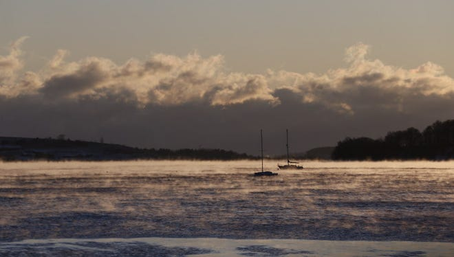 Sea smoke, or steam fog, rises off the water in Dorchester Bay, Boston, Massachusetts. Temperatures for the day started near 0 degrees Fahrenheit and are expected to rise to 14 degrees Fahrenheit.