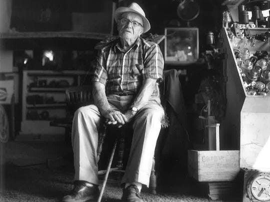 The late Lawrence Burgess, poses in the Americana Museum he started in 1976 in Marion Station.