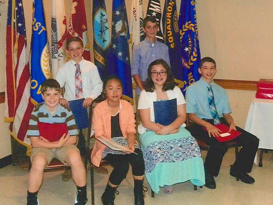 Essay Winners in grades 6 through 8, front row, from left, are: Jeremy Deal, Giovanna Jiang, Olivia Forbes and Ryan Murphy, all of Annunciation BVM; back row: Eduardo Ugarte of Annunciation BVM, and Michael Apgar of St. Joseph Middle. Missing from the photo are: Jordyne Troyer of Annunciation BVM, Kylie Funkhouser of St. Joseph Middle, and Maggie Lawrence of St. Joseph Middle.