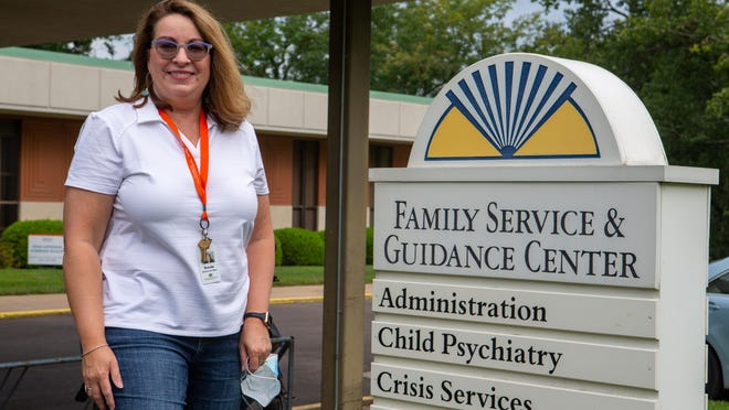 Brenda Mills, CEO of Family Service & Guidance Center, 325 SW Frazier Ave., stands in front of the organization's facility. Family Service & Guidance Center was the recipient of Paycheck Protection Program loan.