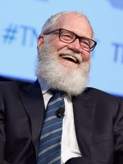 Comedian and former talk show host David Letterman speaks onstage.