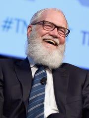 Comedian and former talk show host David Letterman speaks onstage.