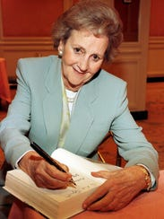 Katharine Graham, attends a book signing luncheon in