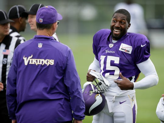 Minnesota Vikings wide receiver Greg Jennings (15) talks with head coach Mike Zimmer, left, during NFL football training camp, Sunday, July 27, 2014, in Mankato, Minn. (AP Photo/Charlie Neibergall)