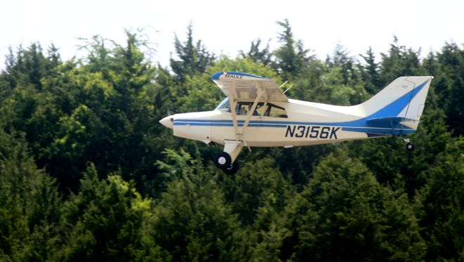 MTSU senior Collin McDonald passes over the Murfreesboro Airport one last time as he starts his flight, on Thursday, May 19, 2016.