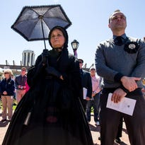 """Pam Brown, center, portrays Mary Todd Lincoln in mourning during the """"Abraham Lincoln: A Day of Remembrance"""" event at Union Square Park, April 15 in Springfield, Ill. The ceremony marked the 150th anniversary of Abraham Lincoln's death on April 15, 1865."""