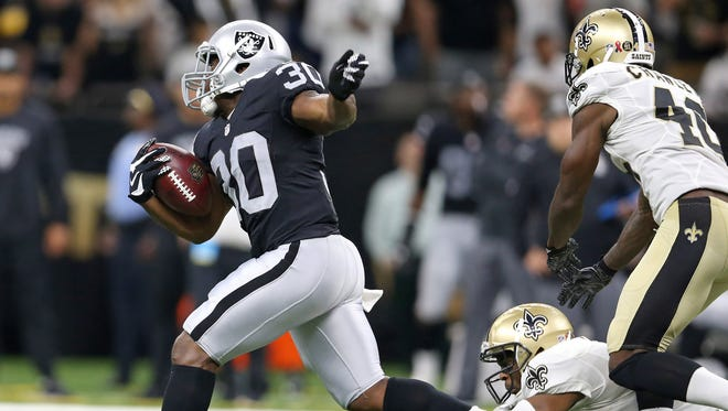 Oakland Raiders running back Jalen Richard (30) takes off on a 75-yard touchdown run against the New Orleans Saints during the fourth quarter Sept. 11, 2016 at the Mercedes-Benz Superdome in New Orleans.