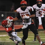 Brookings' Gerald Maxwell eludes Lincoln's Eric Looby during their game at Howard Wood Field on Friday, Sept. 18, 2015.
