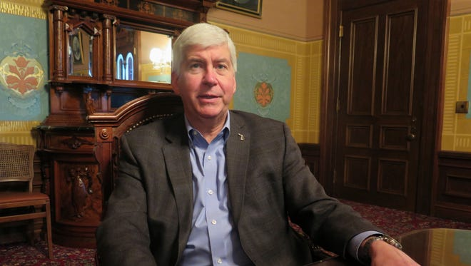 Michigan Gov. Rick Snyder speaks during a year-end interview on Wednesday, Dec. 14, 2016, in his office at the Michigan Capitol in Lansing. Snyder said he wants municipalities and labor unions to jointly study how best to tackle retiree health care costs after Republican lawmakers removed a contentious proposal to aggressively curb the benefits from the postelection agenda. (AP Photo/David Eggert)