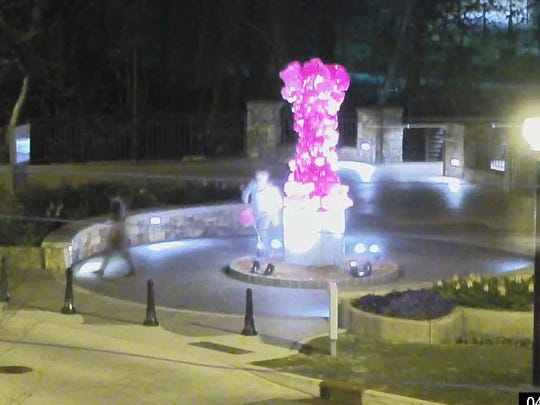 Investigators determined two individuals vandalized the statue about 12:41 a.m. April 4 at 9 University St.