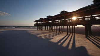 Panama City Beach boasts 27 miles of sugar-white sand beaches bordering the clear, emerald-green waters of the Gulf of Mexico and St. Andrews Bay.