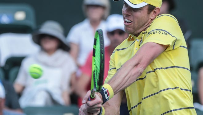 Sam Querrey returns the ball to Yuki Bhambri, of India during the men's 3rd round at the BNP Paribas Open in Indian Wells, Tuesday, March 13, 2018.