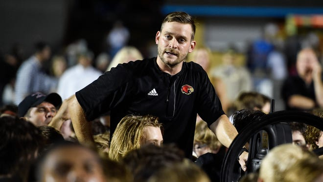 Ravenwood head coach Matt Daniels speaks to his team after they defeated Brentwood at Brentwood High School in Brentwood, Tenn., Friday, Sept. 15, 2017.