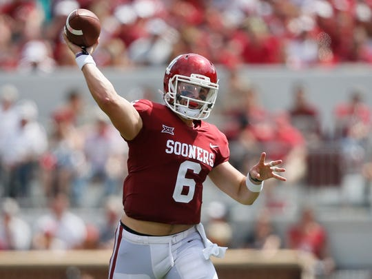 Oklahoma quarterback Baker Mayfield (6) throws in the first quarter of an NCAA college football game against UTEP in Norman, Okla., Saturday, Sept. 2, 2017. (AP Photo/Sue Ogrocki)