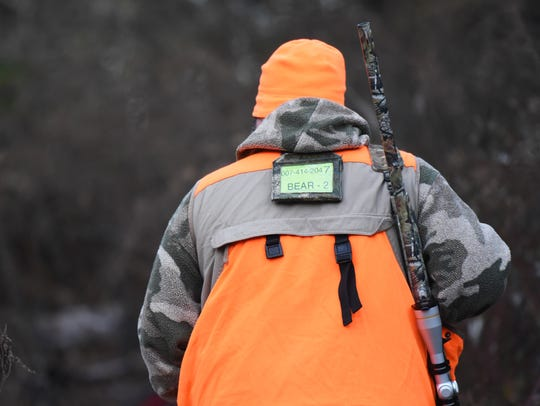 A hunter is shown hunting black bears in this file photo.