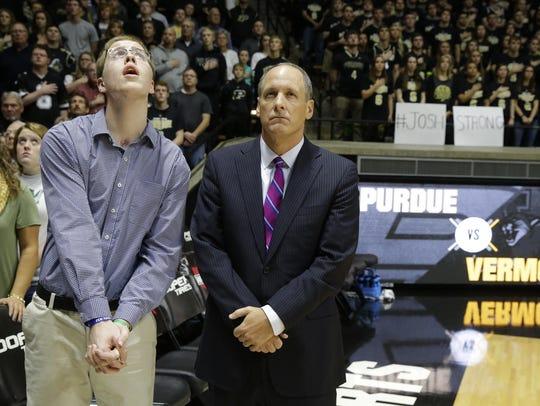 Josh Speidel, left, stands with Vermont head coach
