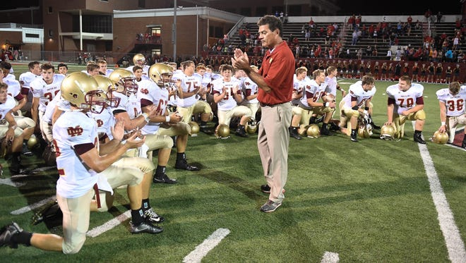 Mater Dei's Mike Goebel, shown talking to his team after a 21-20 overtime win over Owensboro on Aug. 25, has become the winningest  SIAC football coach in history.