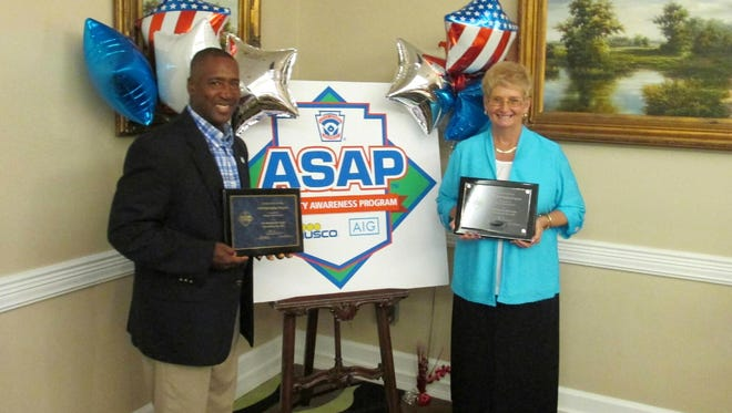 Horseheads Little League Vice President Tony Bellamy and safety manager Linda Miller pose with plaques presented to the league for its focus on safety at a reception Thursday at the Holiday Inn Williamsport.