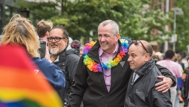 Gov. Phil Murphy greets people  as the Jersey Pride Parade proceeds along Cookman Ave. Asbury Park.