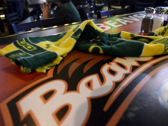 Ducks and Beavers apparel was everywhere at Half Penny Bar & Grill in Salem while fans gather to watch the Oregon vs. Oregon State Civil War football game on Saturday, Nov. 29, 2014.