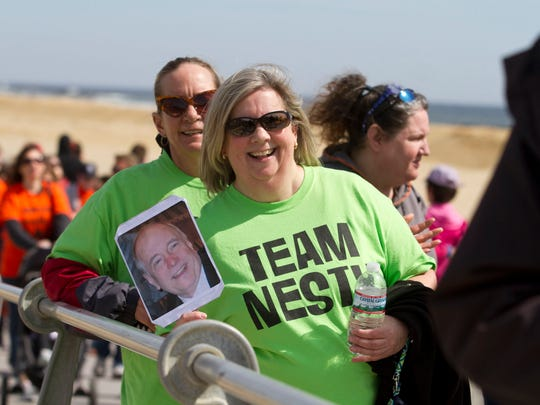 Sandy Nesterwitz of Toms River walks for her husband Mike who suffers from MS along the boardwalk in Spring Lake. Thousands of walkers participate in Walk MS, presented by BAYADA Home Health Care, in Lake Como. This walk is one of many that took place throughout New Jersey over the weekend to raise money to create a world free of multiple sclerosis. Lake Como, NJ Saturday, April 19, 2015 Doug Hood/Staff Photographer @dhoodhood