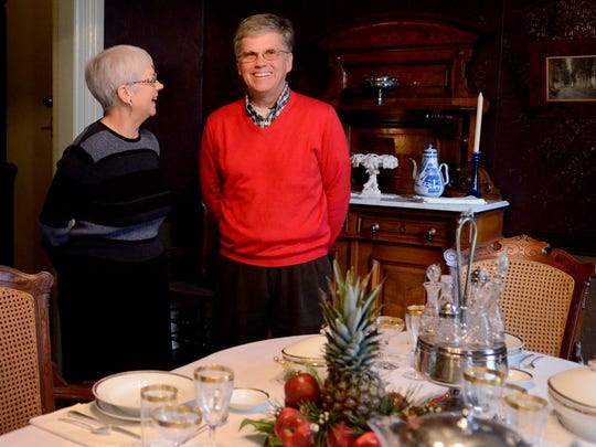 Lana Von Prussing, a tour guide, and Ross Sutherland, the Bush House Museum Director, host a holiday open house at the Bush House in Salem on Sunday, Dec. 7, 2014.