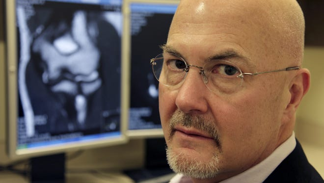 Dr. Tim Kremchek shown with a digital X-ray on the computer display.