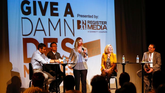 Des Moines Register Editor Amalie Nash introduces the Give a Damn, Des Moines It's NOT a Damn Debate! event at the Des Moines Social Club on Thursday, Nov. 5, 2015.