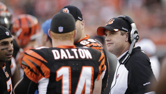 Former Bengals offensive coordinator Jay Gruden talks with Andy Dalton and other quarterbacks in the fourth quarter after Dalton's second interception. The Cincinnati Bengals lost 24-17 to the Pittsburgh Steelers at Paul Brown Stadium in NFL action.